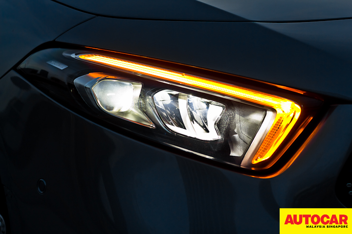 An image of the Mercedes-Benz A250 Sedan AMG Line LED headlights in the dark