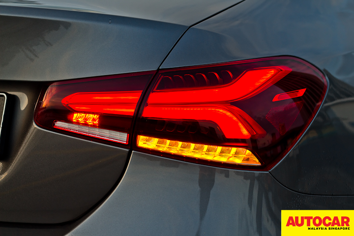 An image of the Mercedes-Benz A250 Sedan AMG Line LED tailights in the dark