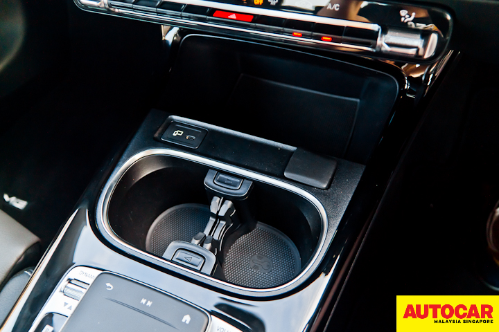 An image of the Mercedes-Benz A250 Sedan AMG lower centre console with cup holders and cubby