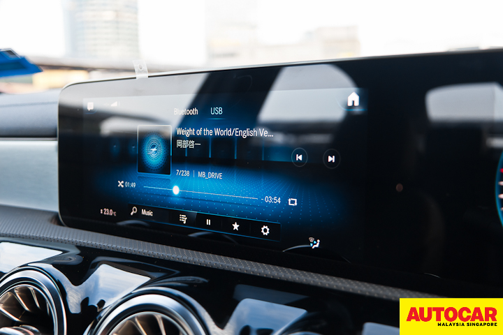 An image of the Mercedes-Benz A250 Sedan AMG Line infortainment playing Weight of the World English version from NieR: Automata soundtrack