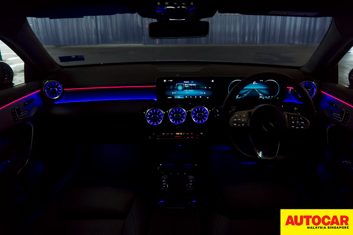 An image of the Mercedes-Benz A250 Sedan AMG interior in the dark with Lounge mood lighting