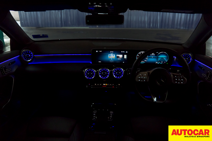 An image of the Mercedes-Benz A250 Sedan AMG interior in the dark with Trip theme mood lighting